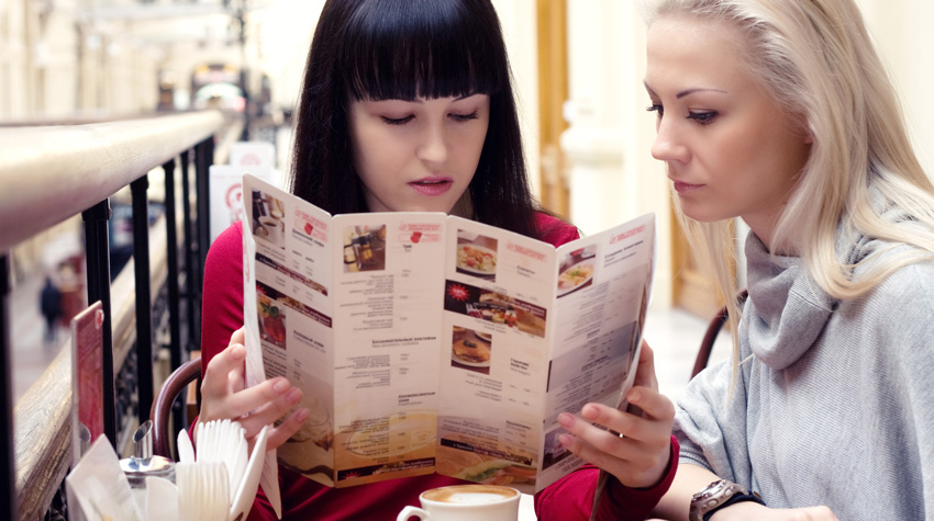 woman holding menu