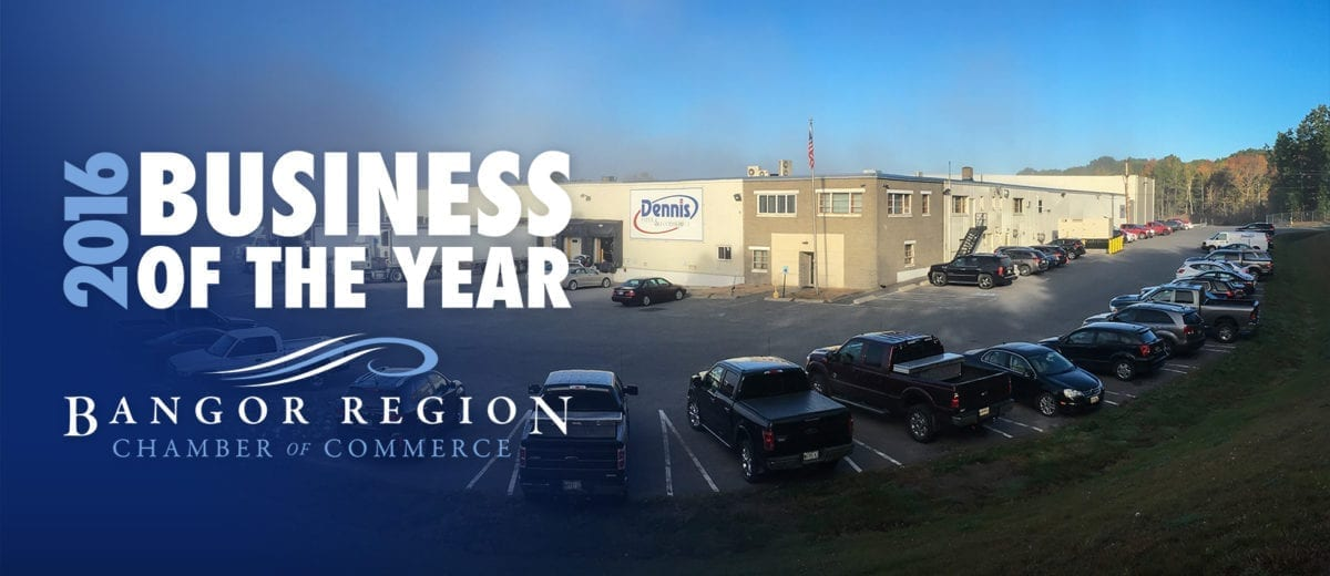 Business of the Year banner in front of Dennis Paper warehouse