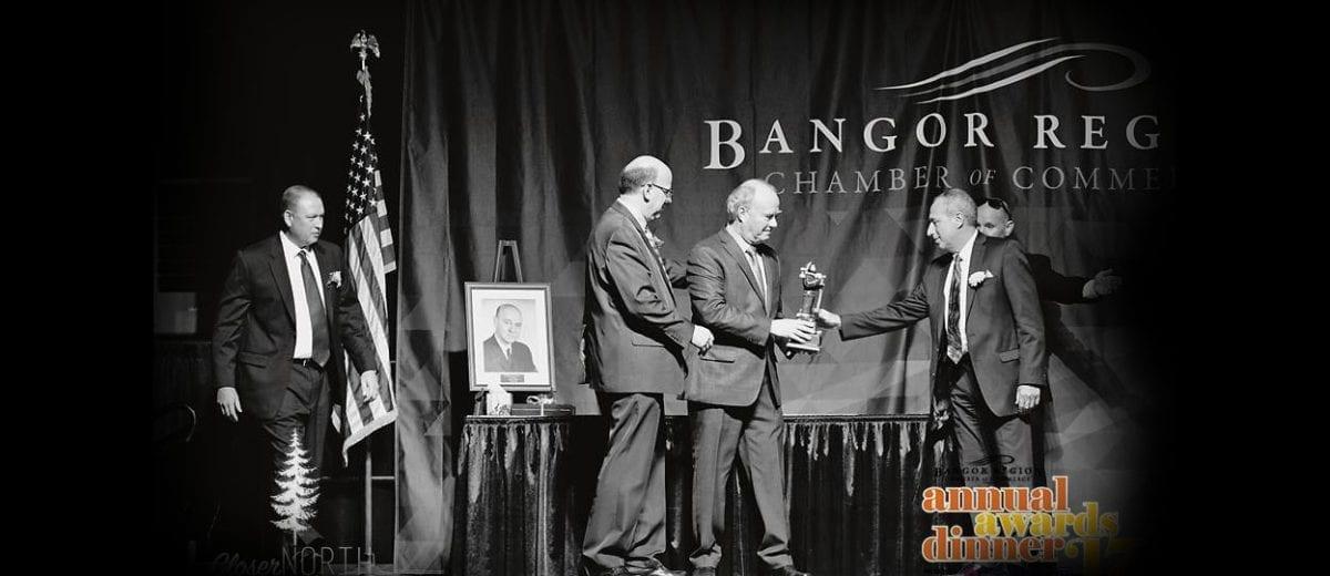 Men accepting award