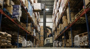 food warehouse aisle with fork lift