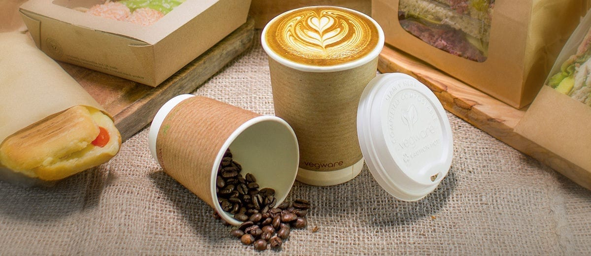 kraft paper coffee cups with coffee beans and latte foam