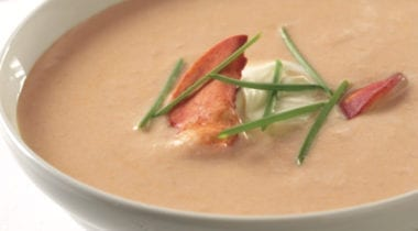 lobster bisque in a bowl with garnish
