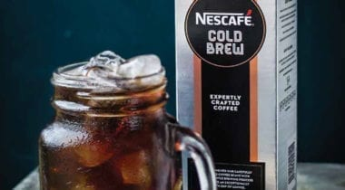 nescafe iced coffee concentrate carton with glass mug of iced coffee