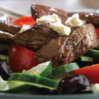 salad with steak, tomatoes and cheese crumbles
