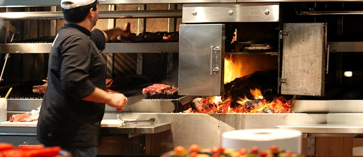 man grilling in restaurant kitchen