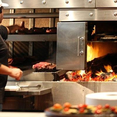 man grilling in restaurant kitchen