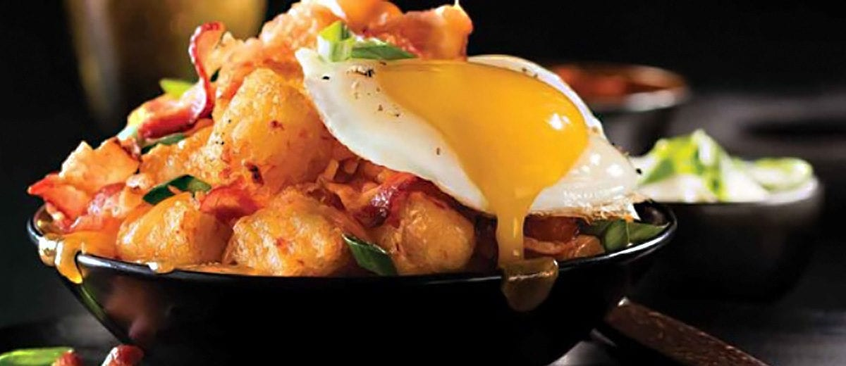 tater tots topped with bacon and eggs