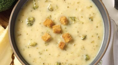broccoli cheddar soup in a bowl with croutons