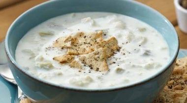 haddock chowder in blue bowl with garnish