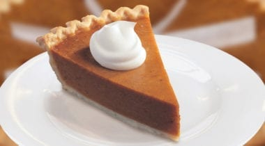 pumpkin pie slice with whip cream