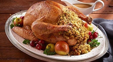 roast turkey with stuffing and decorative plating