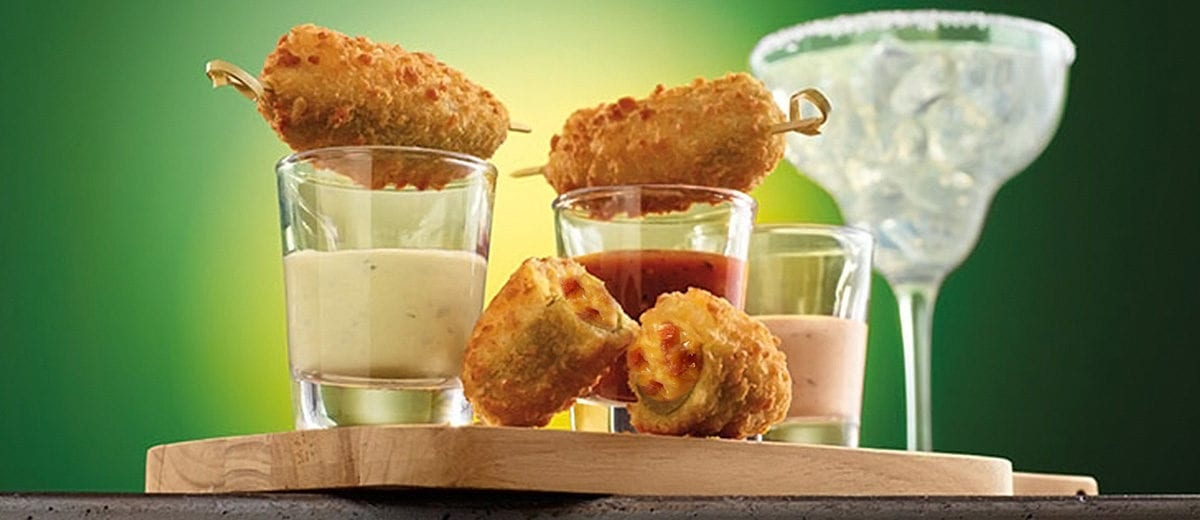 bacon cheddar jalapeno poppers with sauces in shot glasses
