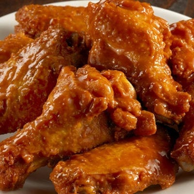 plate of chicken wings and legs