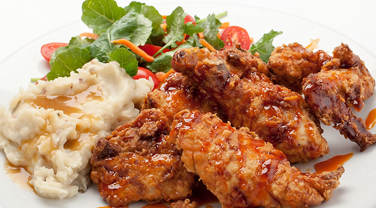 honey hot chicken wings with mashed potatoes and salad