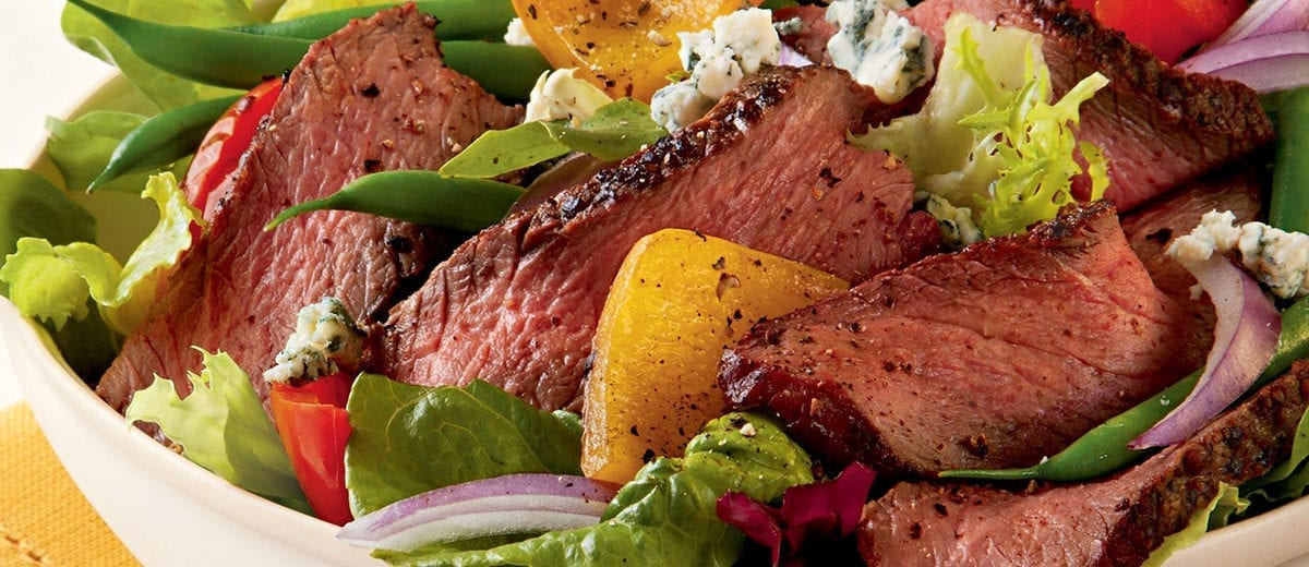 salad with sliced beef and bleu cheese