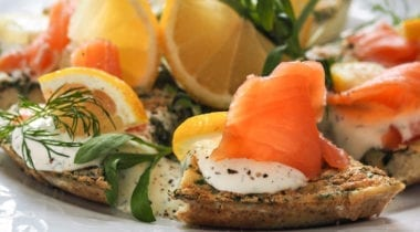 smoked salmon appetizer with lemon wedges