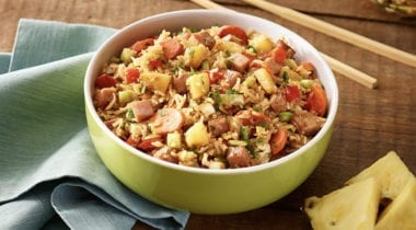 fried rice with pineapple, ham and sliced sausage