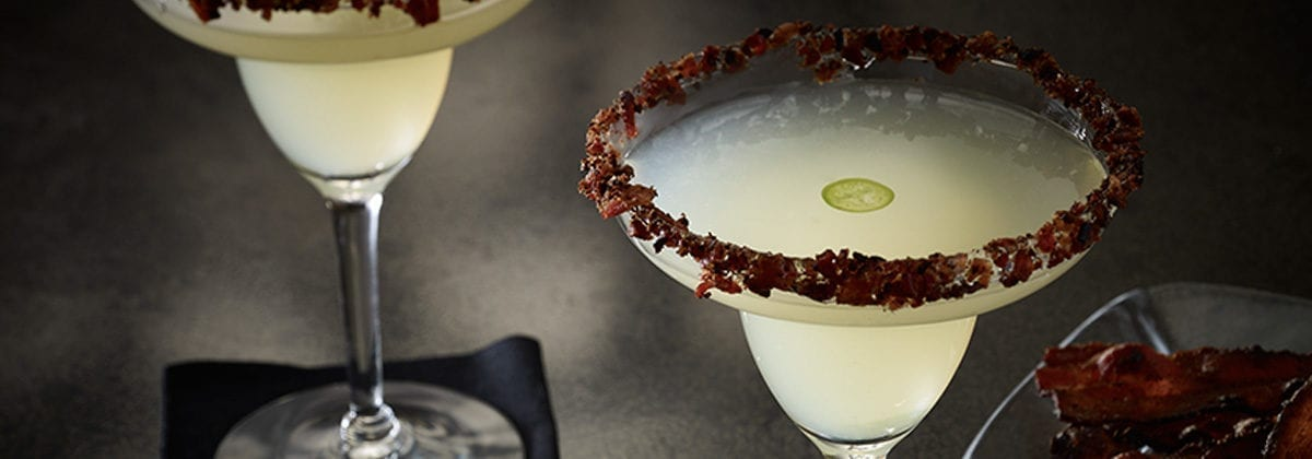 margarita with jalapeno slice floating in it and bacon on the rim. mmm, bacon