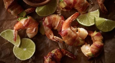 bacon wrapped shrimp with lime slices