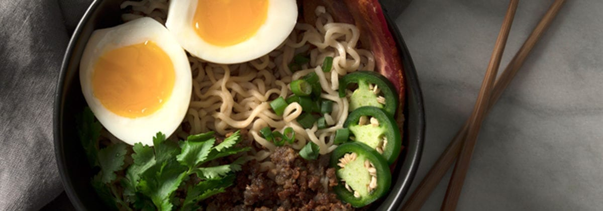 ramen bowl with jalapeno, beef, bacon and eggs