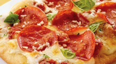 pepperoni pizza with basil and grated parmesan