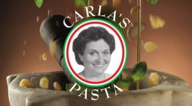 carla's pasta logo with pine nuts falling backdrop