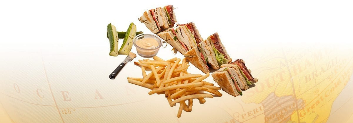 chicken club sandwich with fries and pickles