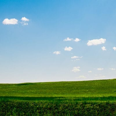field and blue sky landscape