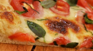 cheese, tomato and basil pizza slice