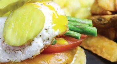 chicken burger with pickles, eggs and fries