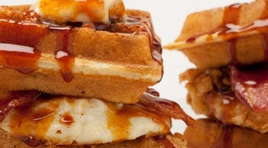chicken and waffles, egg and syrup sandwich