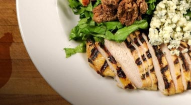 sliced grilled chicken with salad