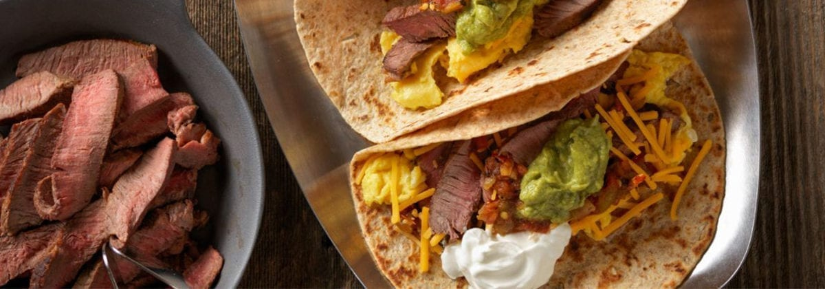 beef taco with guacamole cheese and sour cream