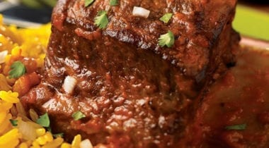 chipotle braised beef ribs with yellow rice