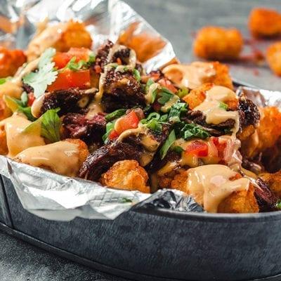 tater tot nachos topped with kogi sauce