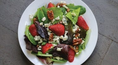 strawberry balsamic salad with cheese crumbles