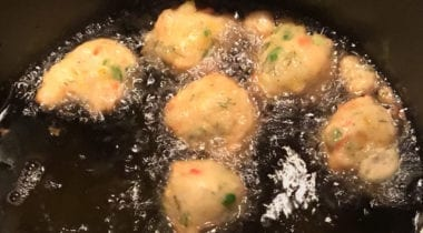 shrimp fritters frying in pan