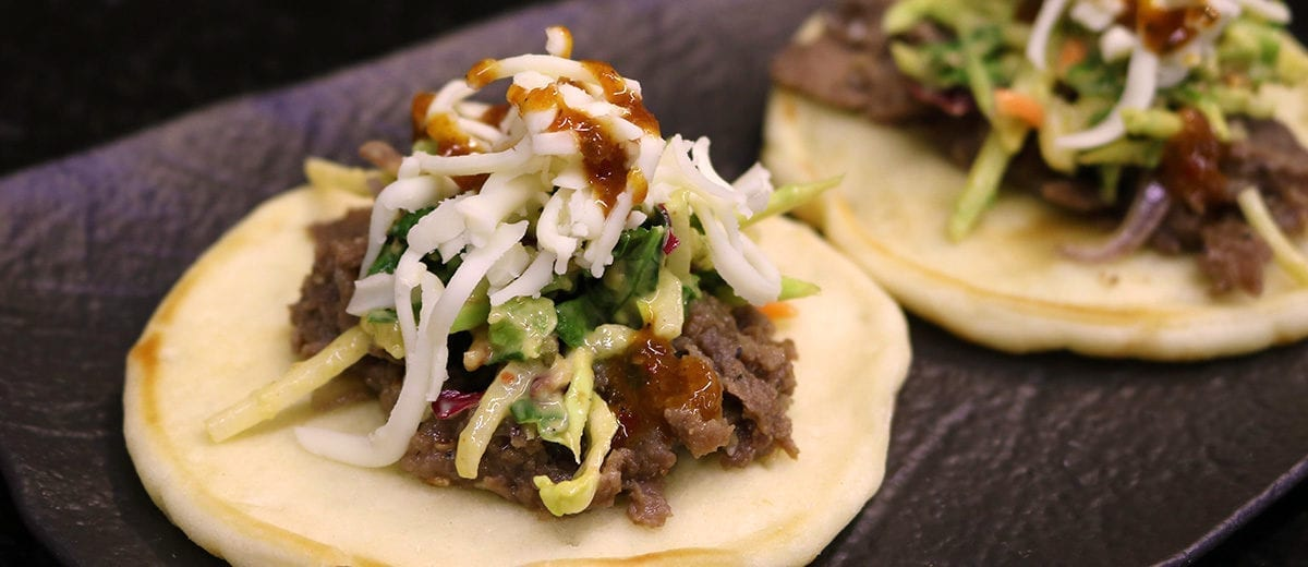 sesame beef with slaw on naan