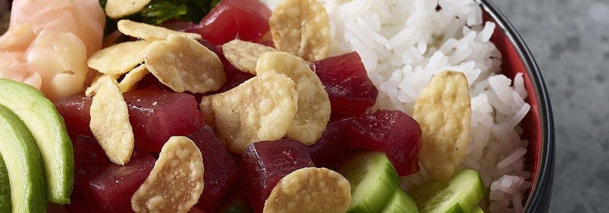 crispy garlic chips on sashimi salad