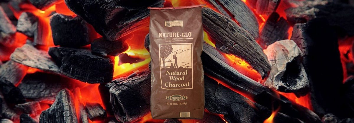 nature glow wood charcoal in bag with coals and fire