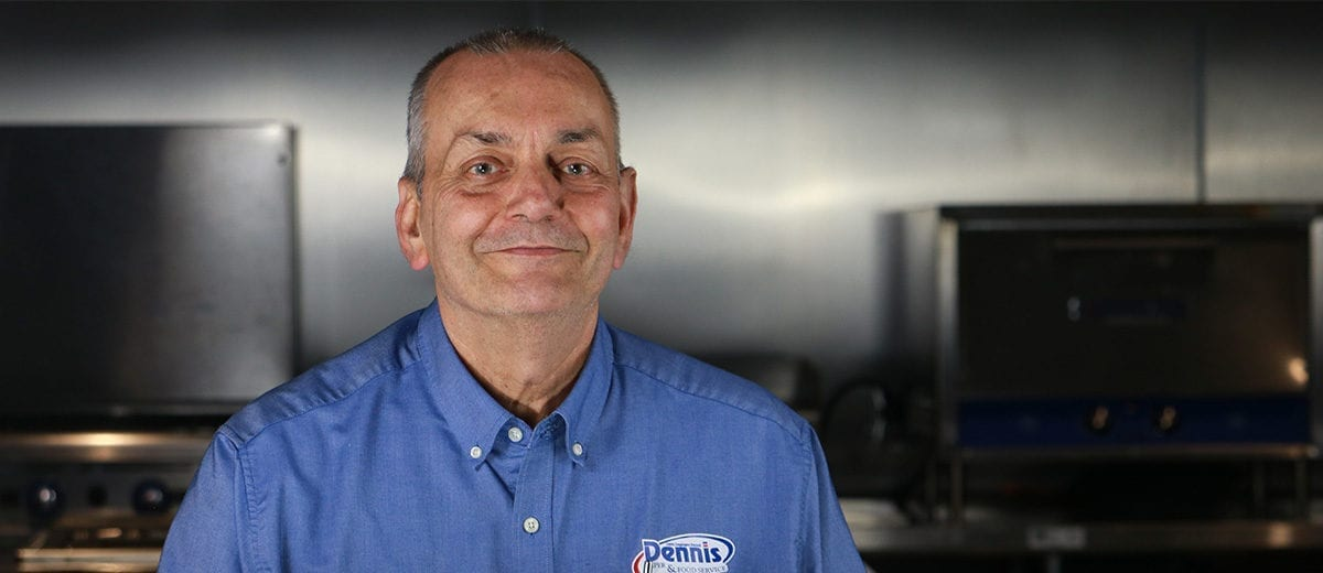 smiling employee in kitchen