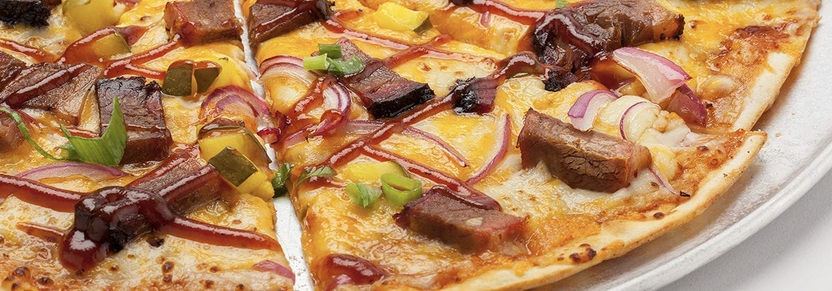 thin crust pizza with meat and jalapenos