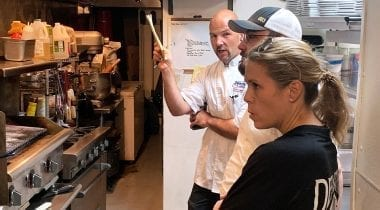chef consulting in kitchen