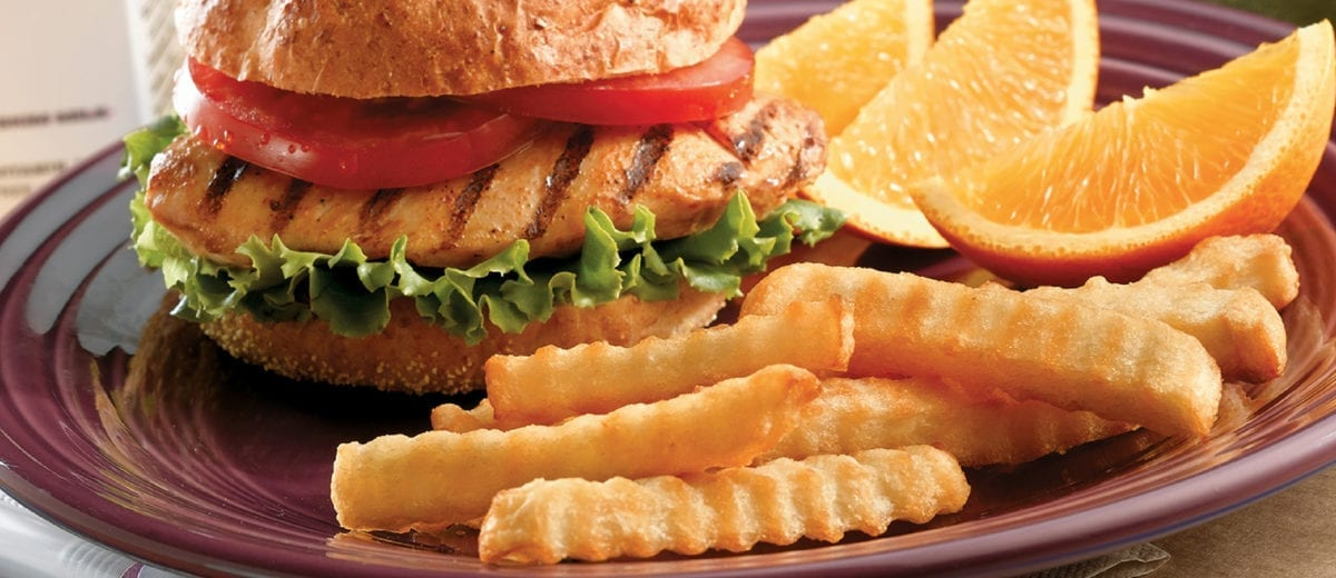 french fries and chicken sandwich lemon wedges