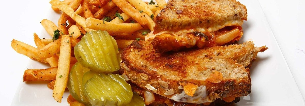 sriracha grilled cheese sandwich with pickles and fries