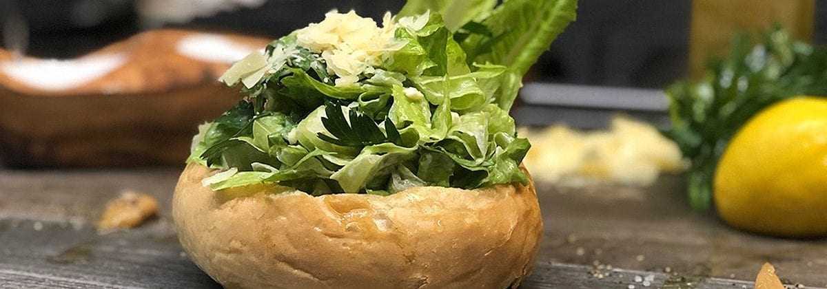 caesar salad in a bread bowl