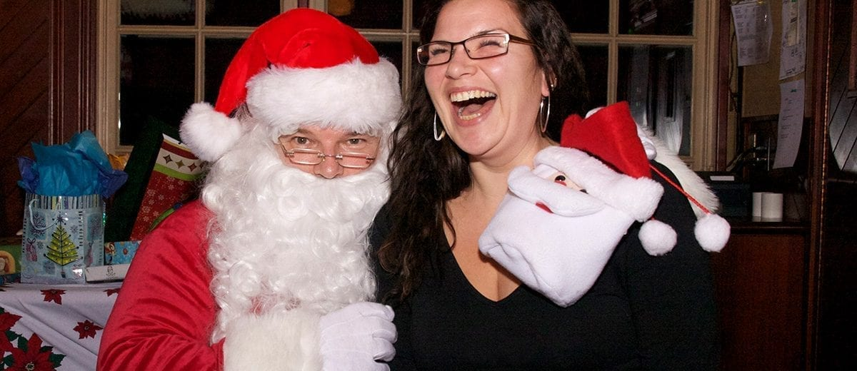 woman laughing on santa's lap