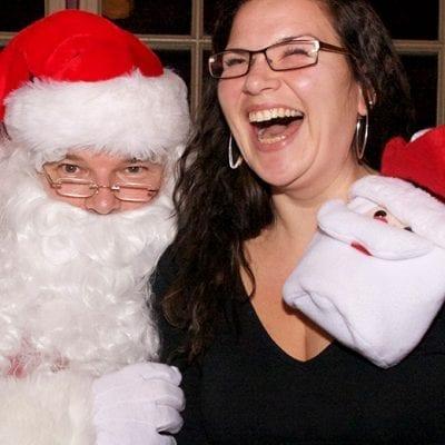woman laughing on santa's lap