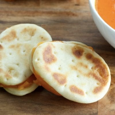 mini naan bread and bowls of sauce