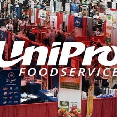 UniPro Logo Over Tradeshow Backdrop
